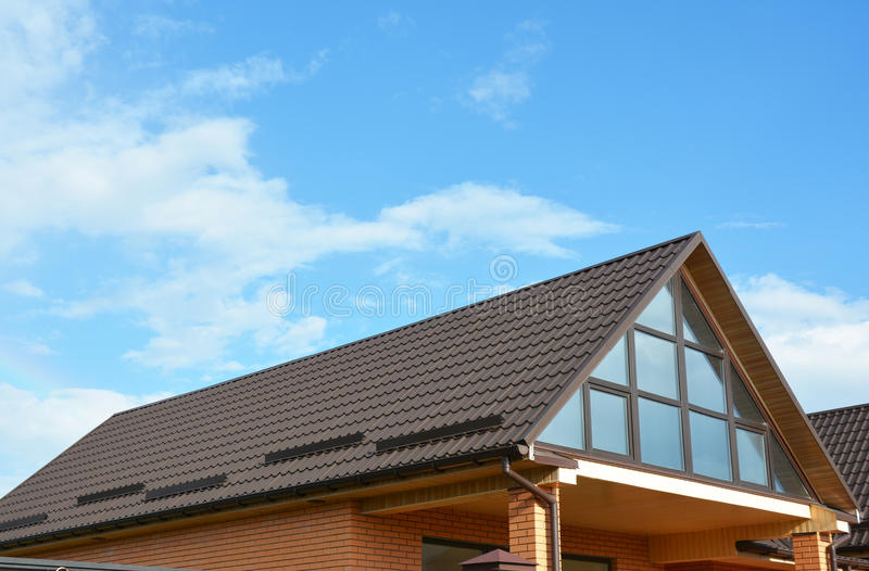 Building new house with beautiful roof windows, skylights. Roofing construction. Building house with beautiful roof windows, skylights. Roofing construction royalty free stock photography
