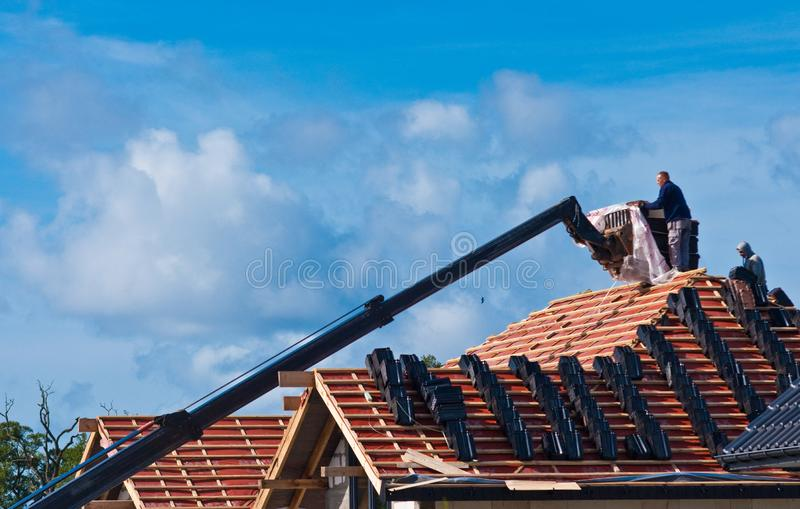 Building a new roof for a private house stock photos