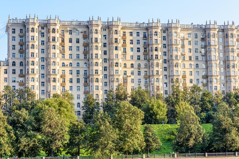 Building opposite the Moscow-City district in Moscow, Russia. Old residential building on the Taras Shevchenko embankment at Moskva River. Scenic view of the royalty free stock photo