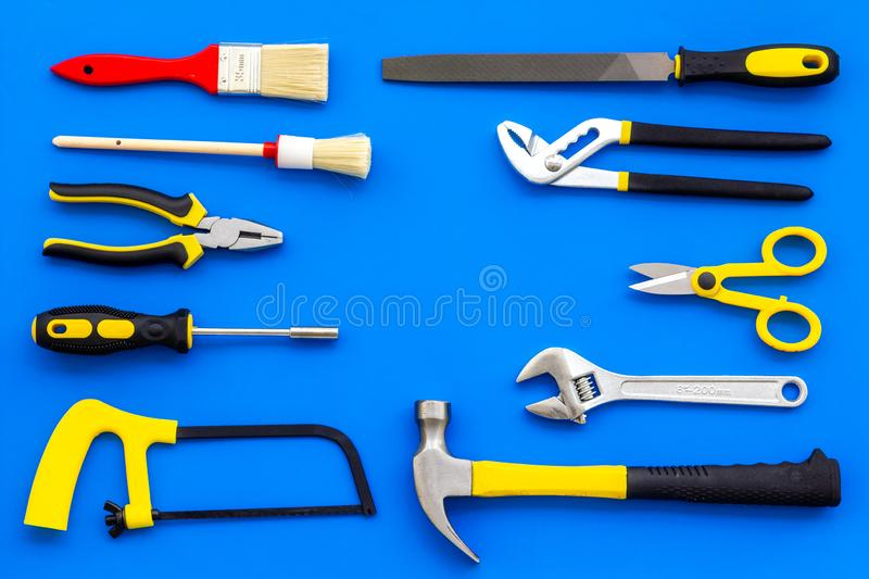 Building, painting and repair tools for house constructor work place set blue background top view pattern. Building, painting and repair tools for house stock images