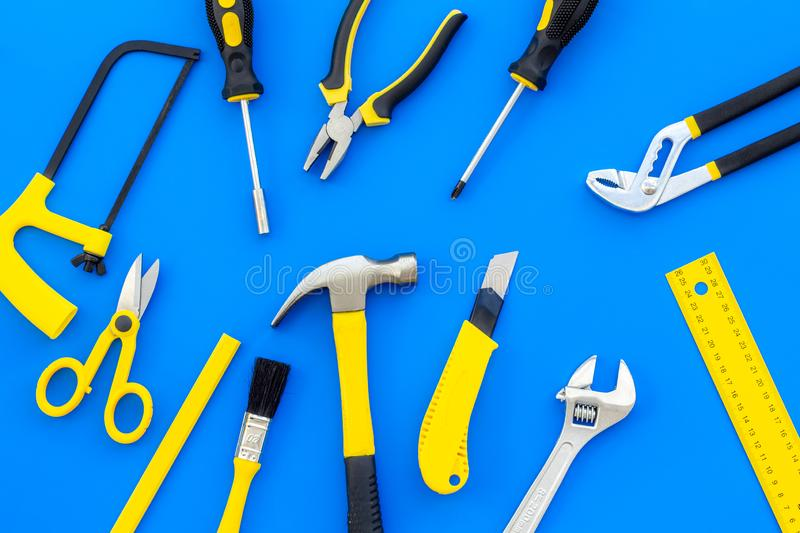 Building, painting and repair tools for house constructor work place set blue background top view pattern. Building, painting and repair tools for house stock photo