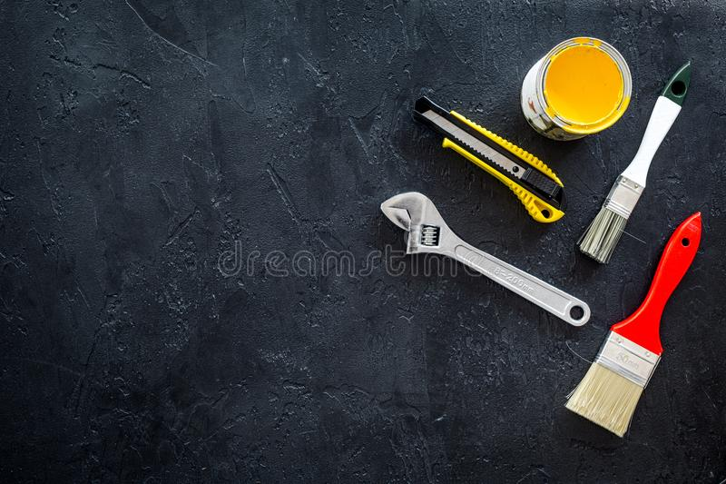 Building, painting and repair tools for house constructor work place set dark background top view space for text. Building, painting and repair tools for house stock images