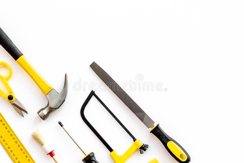 Building, painting and repair tools for house constructor work place set white background top view space for text. Building, painting and repair tools for house stock photography