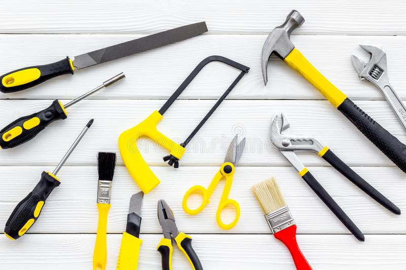 Building, painting and repair tools for house constructor work place set wooden white background top view pattern. Building, painting and repair tools for house royalty free stock photo
