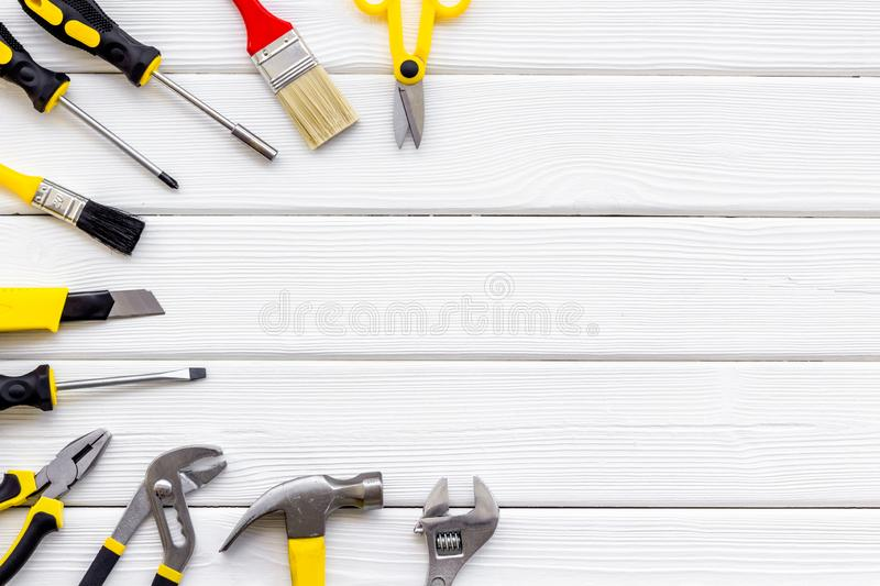 Building, painting and repair tools for house constructor work place set wooden white background top view space for text. Building, painting and repair tools for royalty free stock image