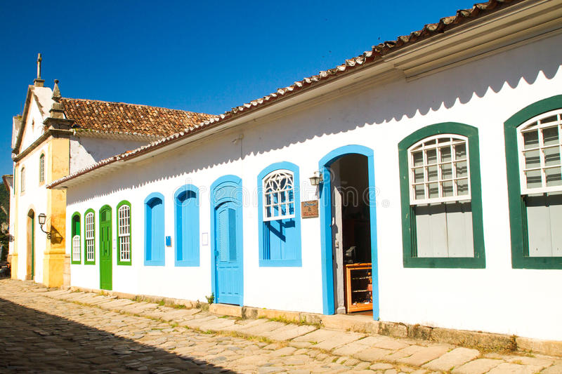 Building in Paraty, Rio de Janeiro. MARCH 27 - PARATY: Typical historical buildings with colorful wooden doors and windows in the colonial downtown of Paraty royalty free stock image