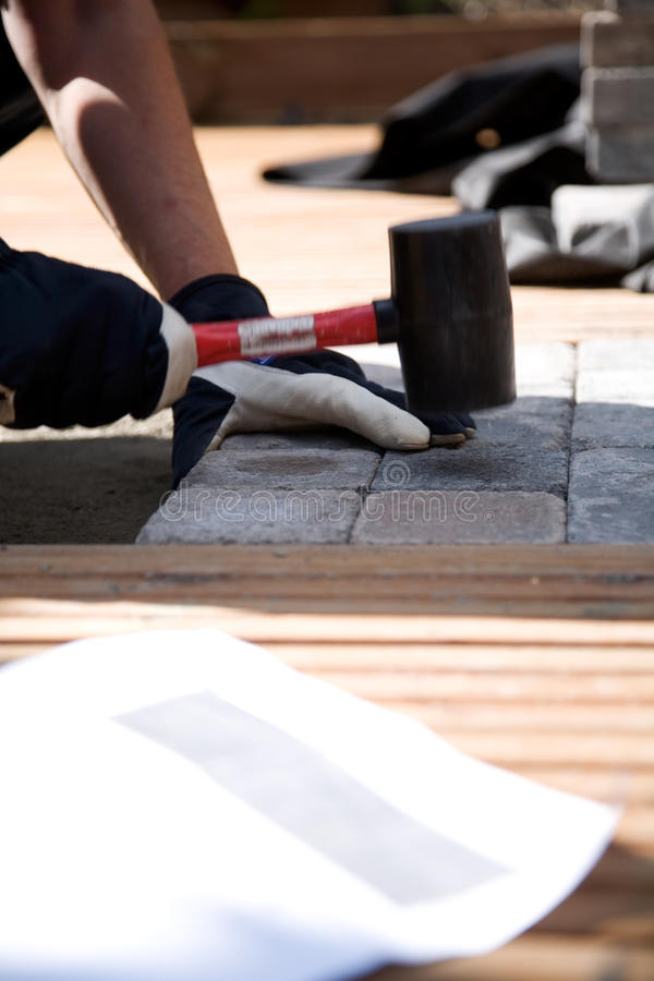 Building a patio stock images
