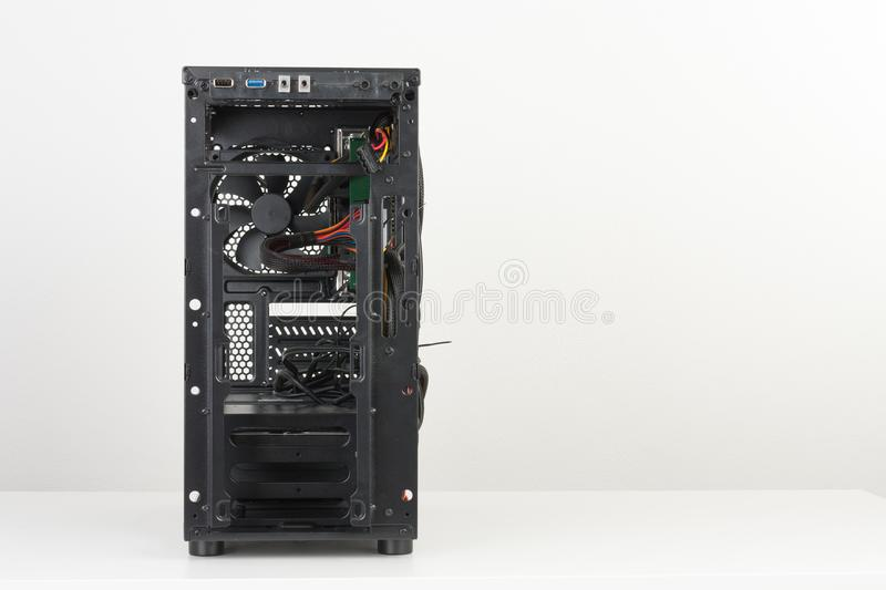 Building of PC, ATX motherboard inserted to black computer midi stock photography