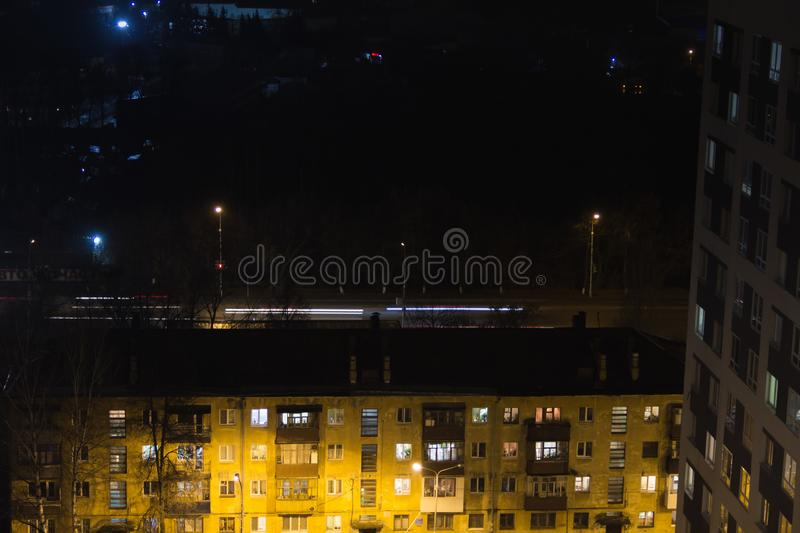 Building with people silhouettes in windows.People waite bus on busstop with traffic light. Aerial panoramic view from tower royalty free stock photo