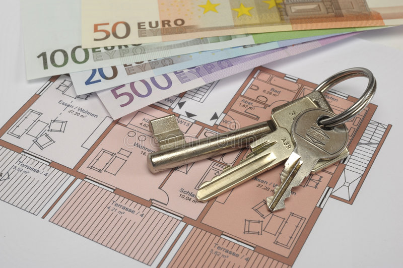 Building plan with keys and money. An architectonic or construction plan for building a house, symbolic with money and key royalty free stock image