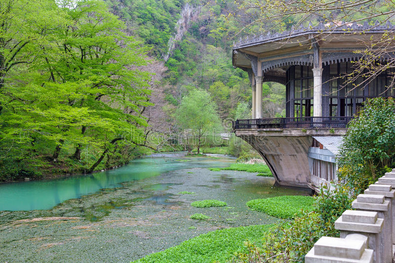 Building and pond with blue water in New Athos stock photos