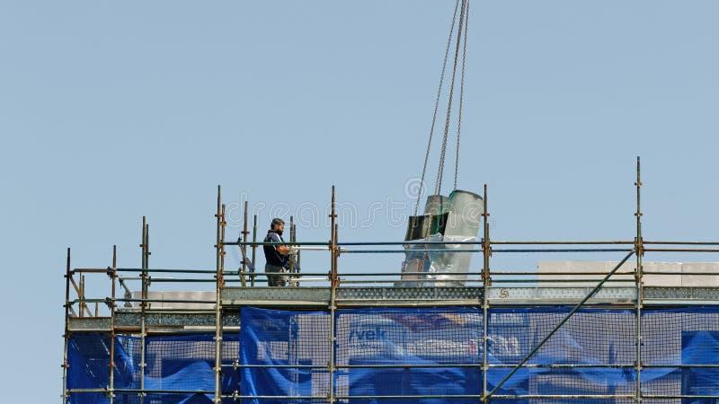 Building progress 158. At 47 Beane St. Gosford. November 2018. Gosford, New South Wales, Australia - November 30, 2018: Crane operator in control of equipment stock photos