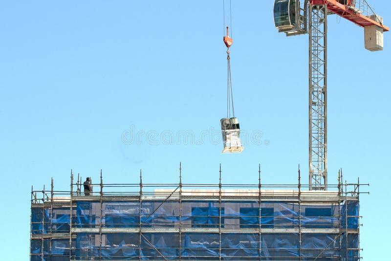 Building progress 156. At 47 Beane St. Gosford. November 2018. Gosford, New South Wales, Australia - November 30, 2018: Crane operator managing Equipment delivey stock photo