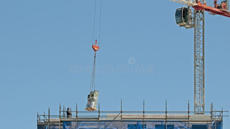 Building progress 157. At 47 Beane St. Gosford. November 2018. Gosford, New South Wales, Australia - November 30, 2018: Equipment delivery by balance crane to stock photography