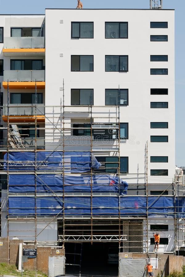 Building progress update 193. At 47 Beane St. Gosford. March 2019. Gosford, New South Wales, Australia - march 4, 2019: Disassembling scaffolding and removing royalty free stock photo