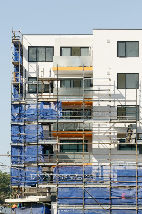 Building progress update 192. At 47 Beane St. Gosford. March 2019. Gosford, New South Wales, Australia - March 4, 2019: Removing safety netting on new home units royalty free stock photography
