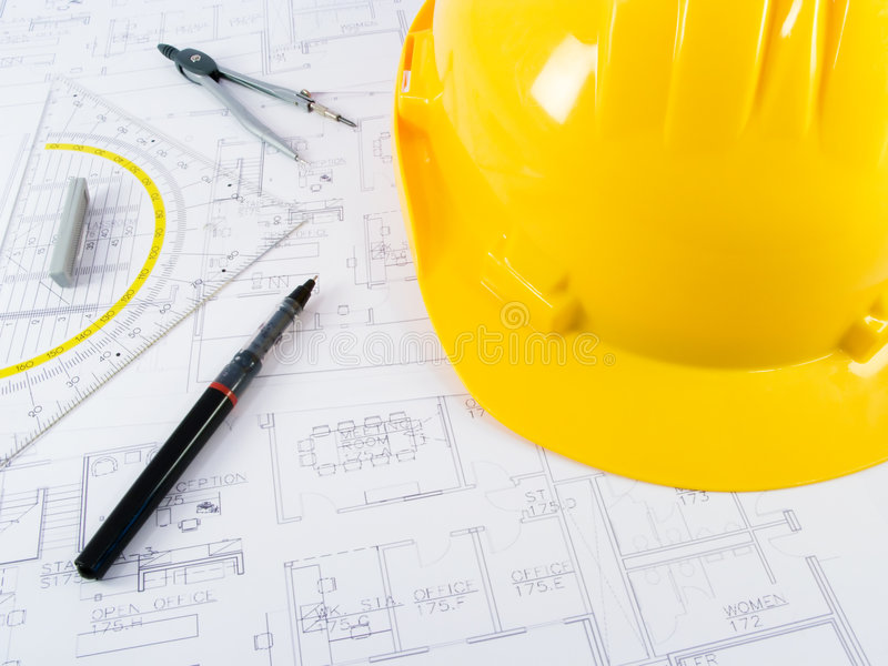Building projects with architect drawing stock photo