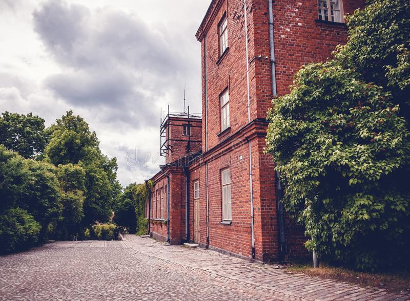 Building of red brick, traditional Scandinavian architecture, He stock photography