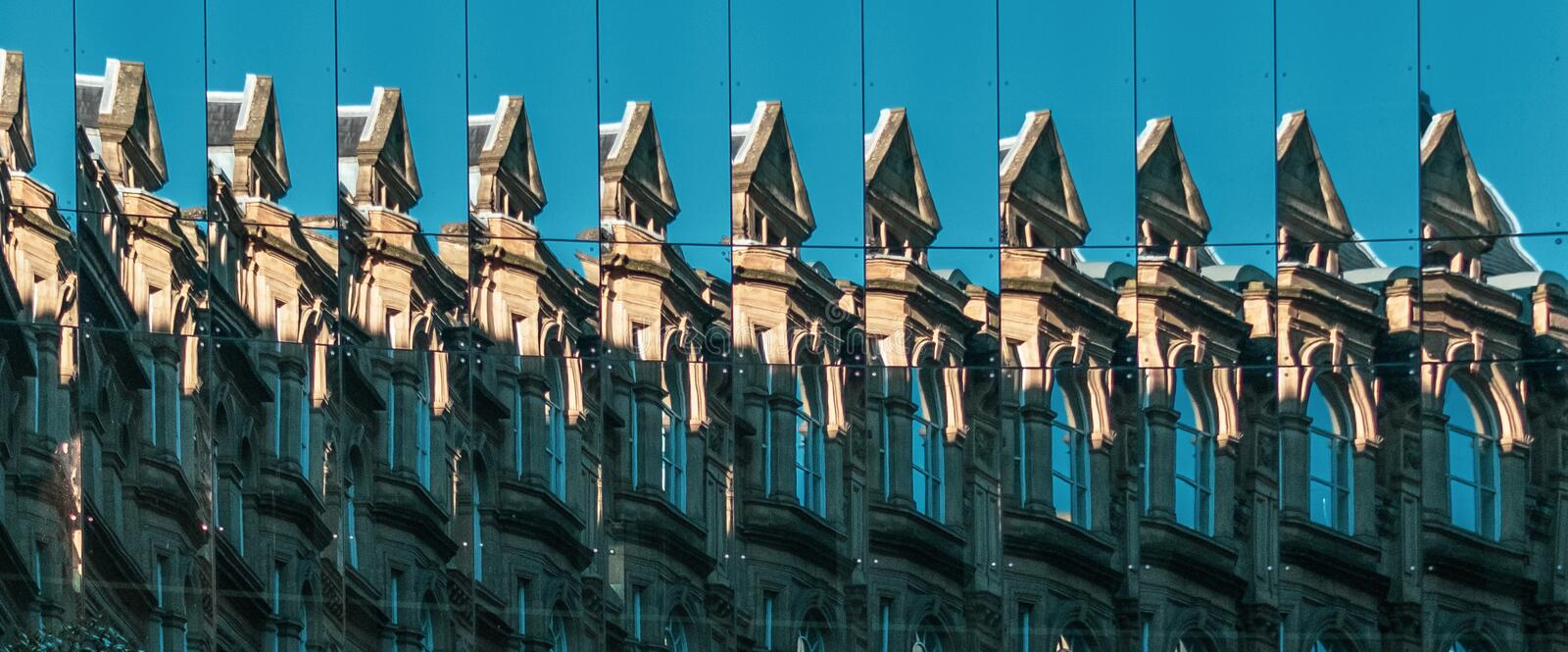 Building Reflected in Multiple Mirrored Windows royalty free stock photo