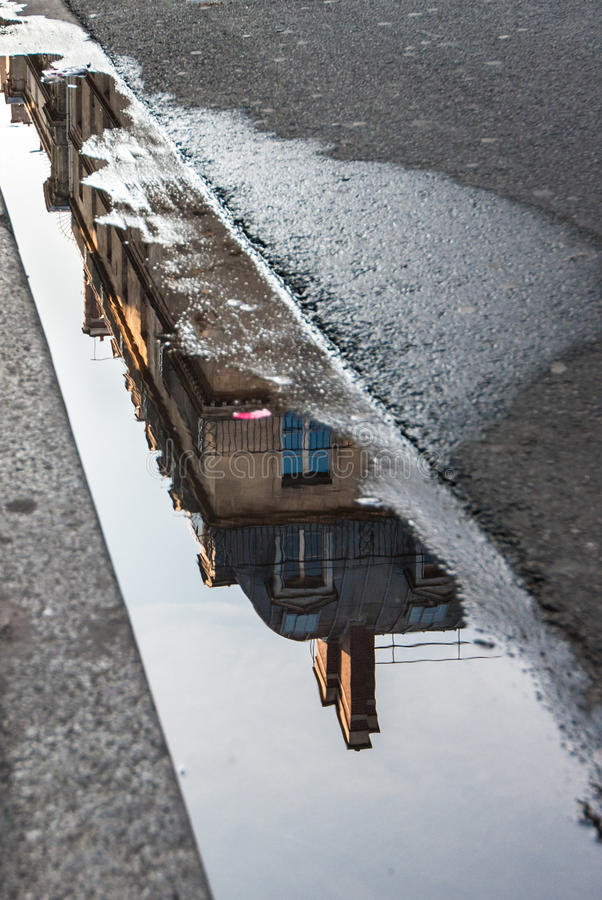 Building reflection in a gutter in Paris royalty free stock photos