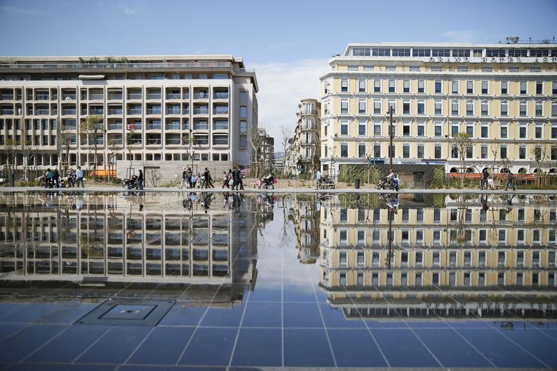 building reflection in watered place south of France royalty free stock image