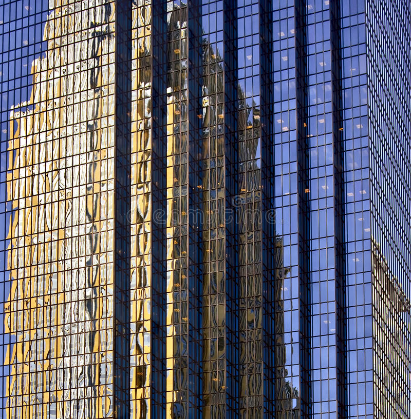 Building Reflections, Minneapolis. A tall modern building is reflected upon another tall modern building of glass in downtown Minneapolis, Minnesota, creating royalty free stock photos