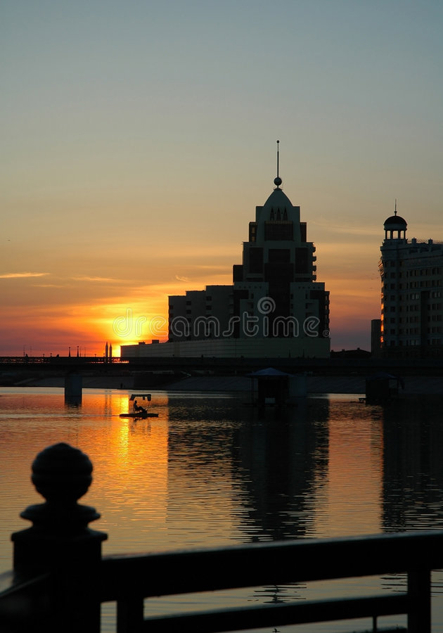 Building on the riverside in the evening Astana royalty free stock images