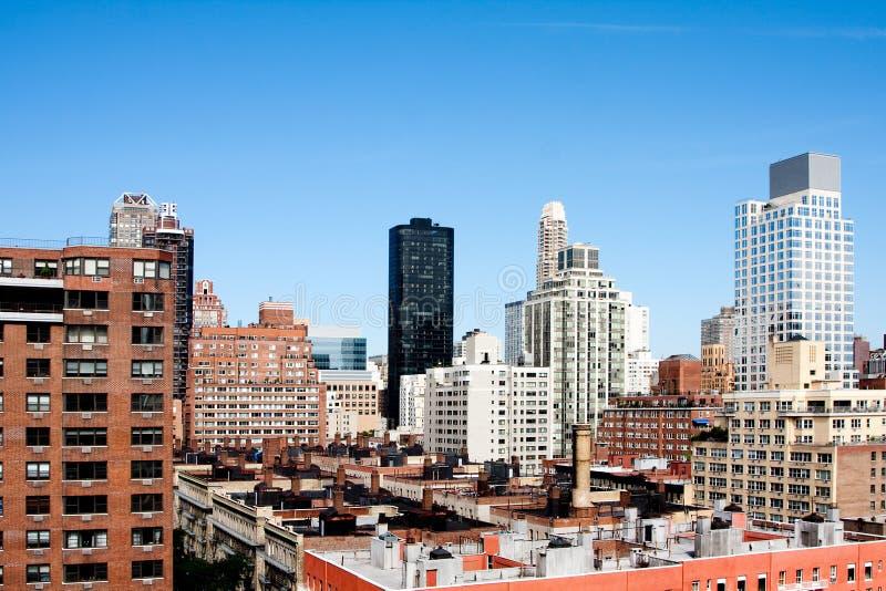 Building rooftops under blue sky stock photos
