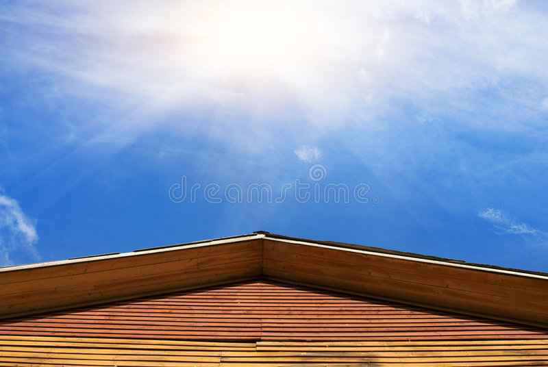 Building's roof and blue sky stock photos