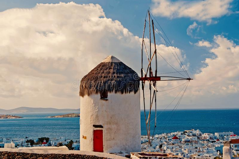 Building with sail and straw roof in Mykonos, Greece. Windmill on mountain landscape on sky. Whitewashed windmill at sea. With nice architecture. Summer royalty free stock photos