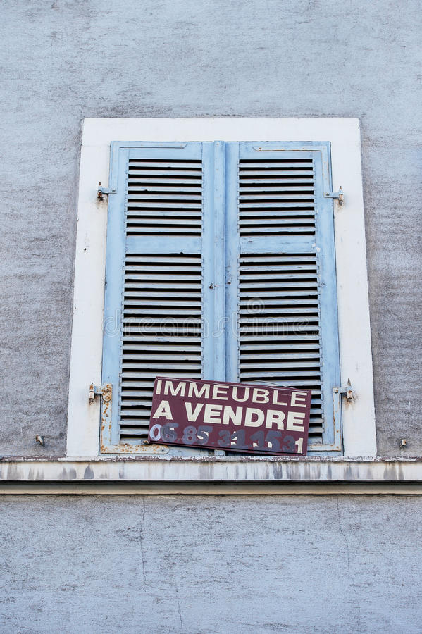 Building for sale - Immeuble a vendre. MULHOUSE, FRANCE - DEC 19, 2015: Building for sale - Immeuble a vendre announce on a building in the French city of stock image