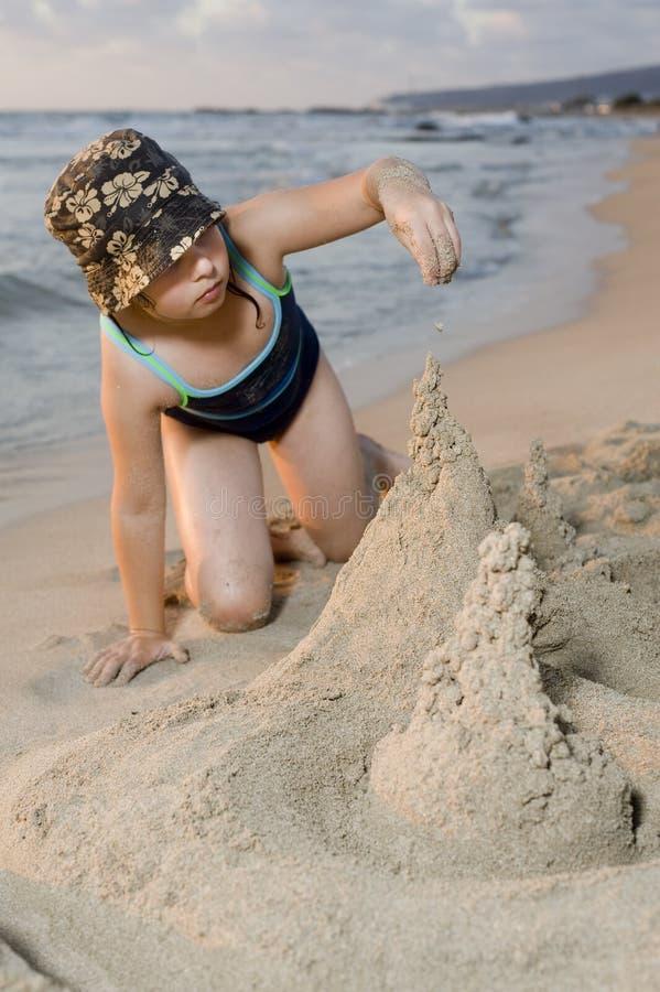 Download Building a sand castel stock photo. Image of resort, children - 10241782