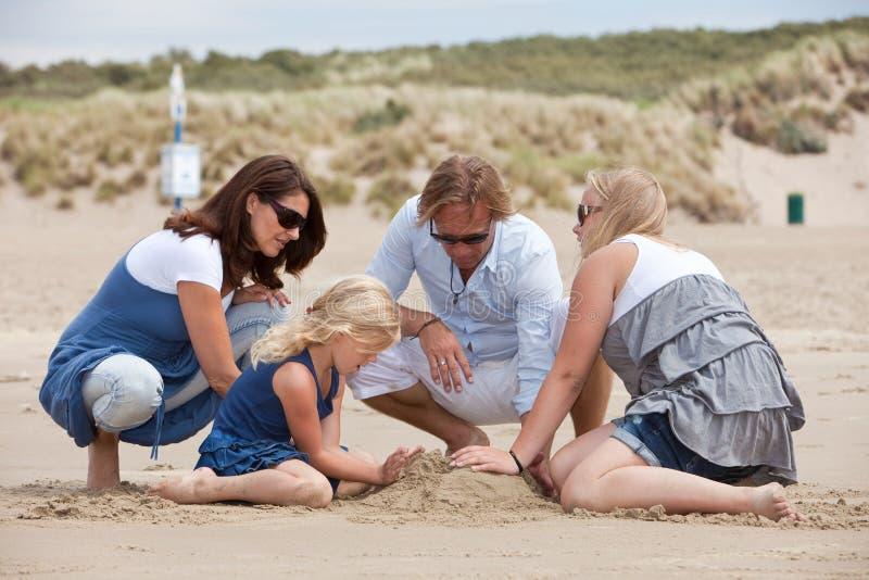Building a sandcastle stock photo