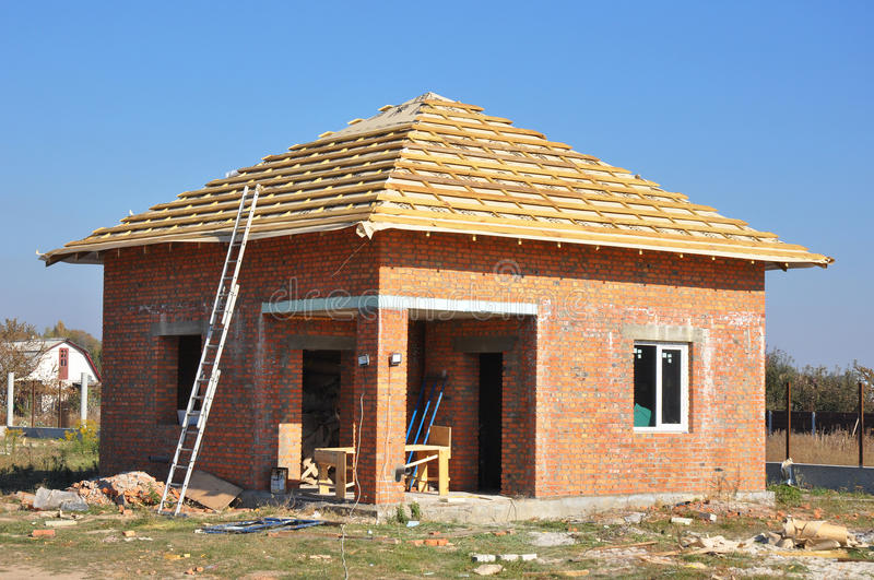 Building sauna or bathhouse from brick with roofing construction. House construction site. royalty free stock image