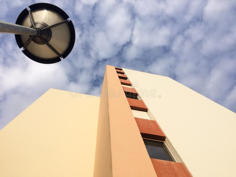 Building seen from below low view with street lighting. A building seen from below low view with street lighting royalty free stock images