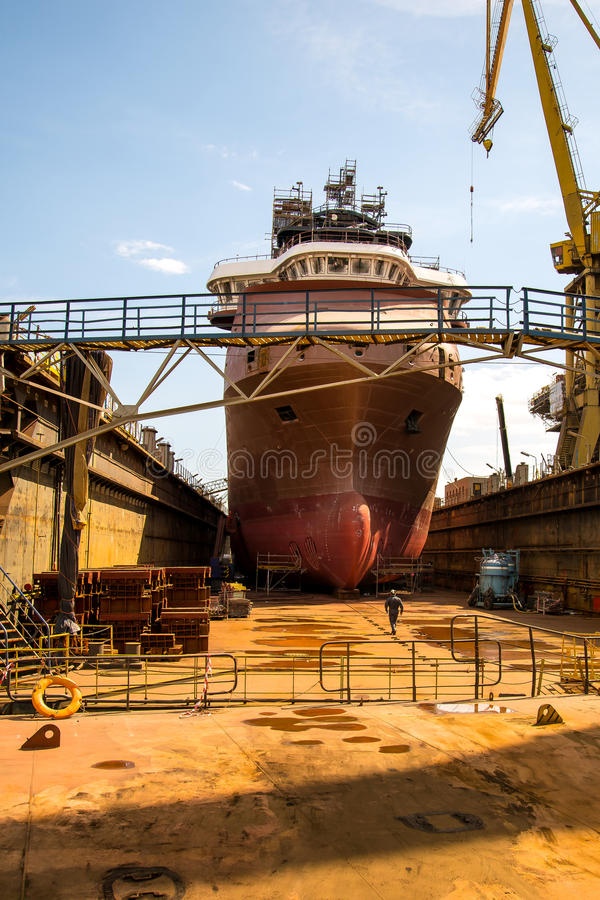 Building the ship. Building a specialized ship at the shipyard dock royalty free stock photos