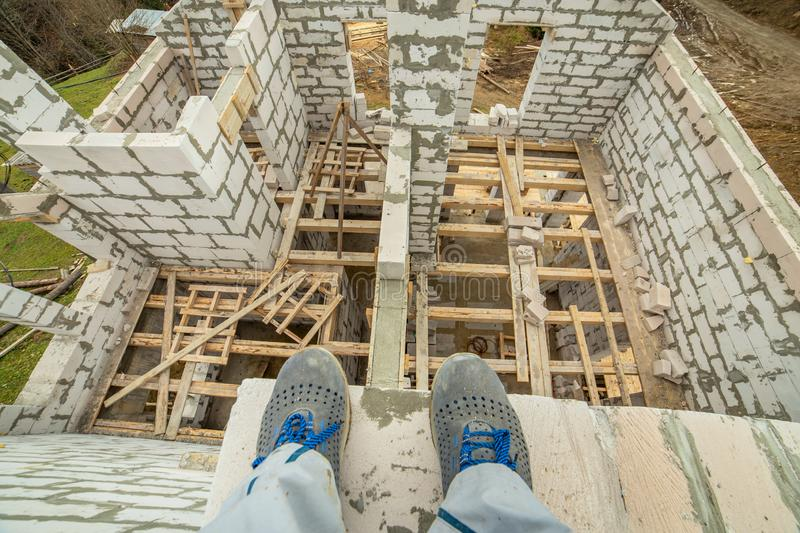 Building site of a house under construction made from white foam concrete blocks royalty free stock image