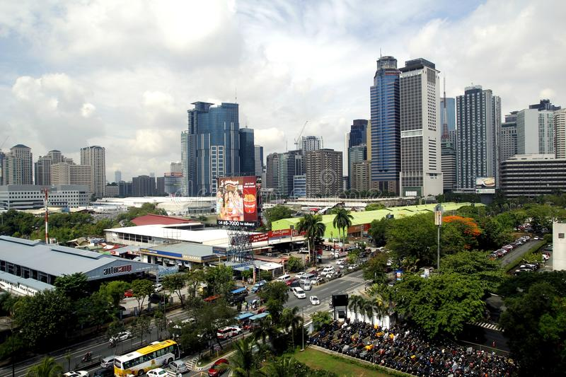 Building, skyscrapers and commercial establishments at Ortigas Complex in Pasig City, Philippines. PASIG CITY, PHILIPPINES - MAY 24, 2016: Building, skyscrapers royalty free stock photo
