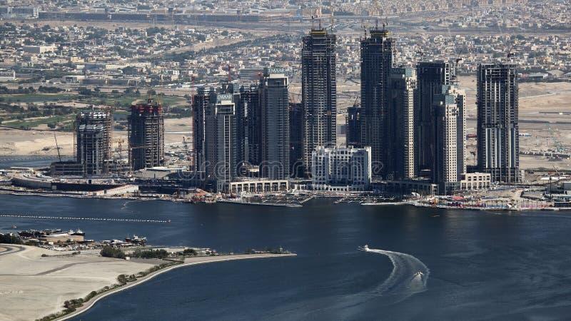 Building skyscrapers in Creek area, Dubai, United Arab Emirates UAE. Oil revenues help accelerate development of Dubai and city still attracts world attention royalty free stock image