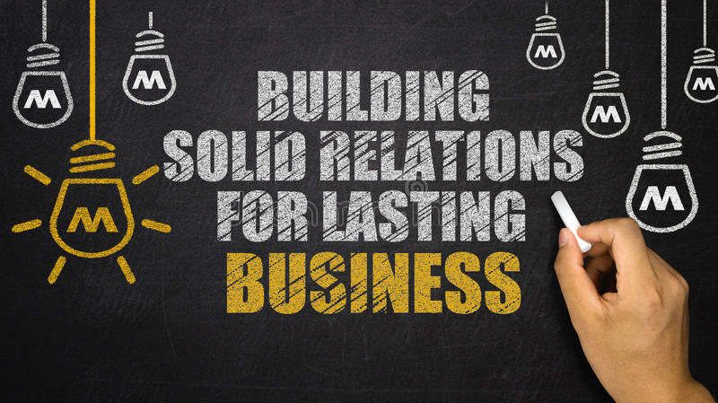 Building Solid Relations For Lasting success. Drawn on blackboard royalty free stock images
