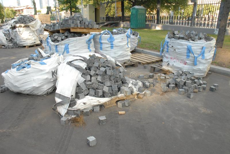 Building stone of gray color and cubic shape - paving stones for paving stock images