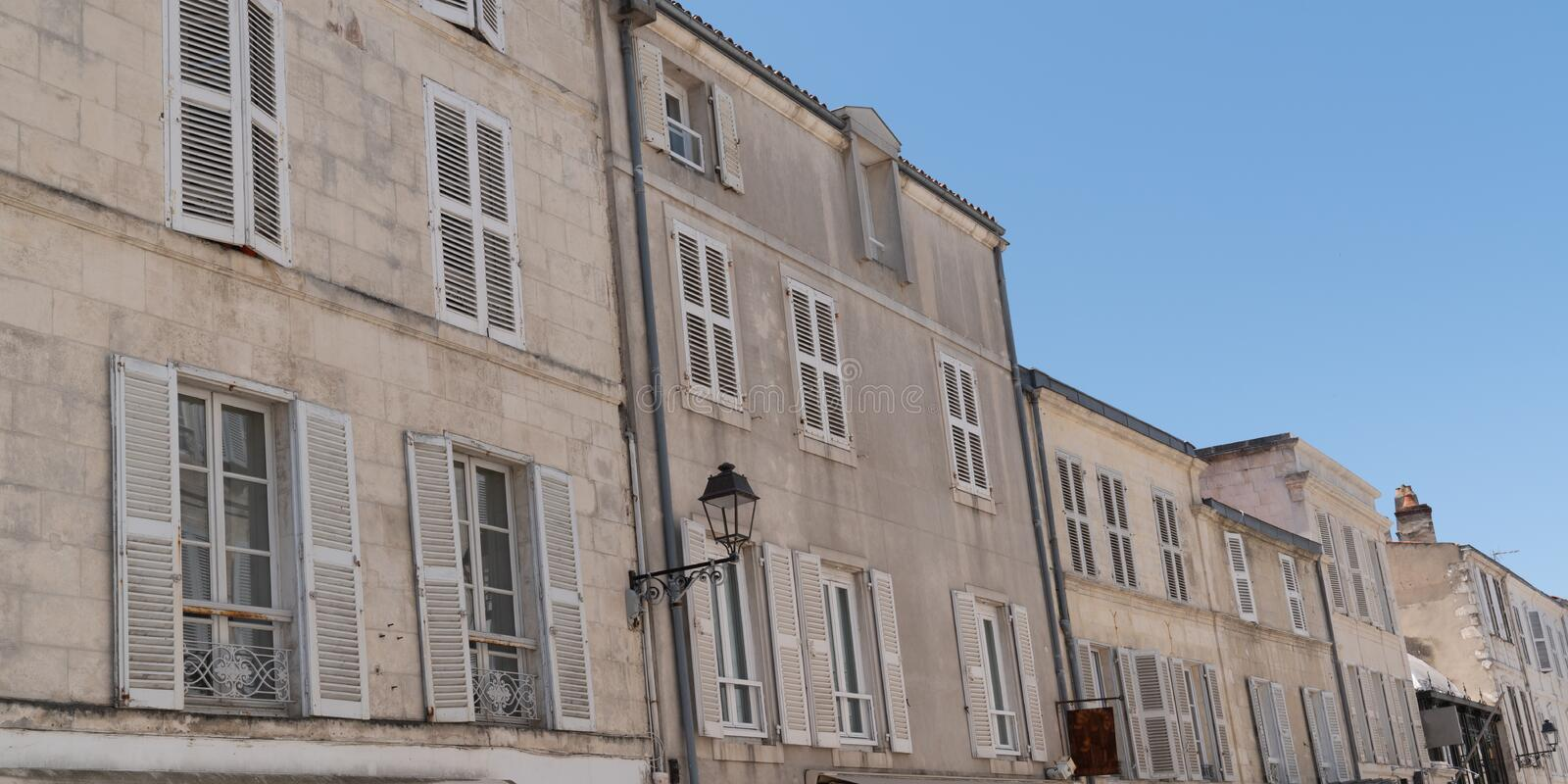 Building in street city seaside of La Rochelle in France in web banner template. A building in street city seaside of La Rochelle in France in web banner stock photo