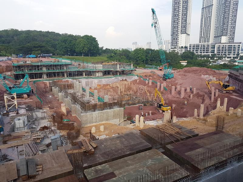 Building substructure and super-structure under construction using the open cut method. KUALA LUMPUR, MALAYSIA -JULY 04, 2018: Building substructure and super royalty free stock photography