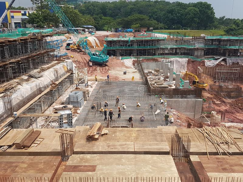 Building substructure and super-structure under construction using the open cut method. KUALA LUMPUR, MALAYSIA -JULY 04, 2018: Building substructure and super stock images