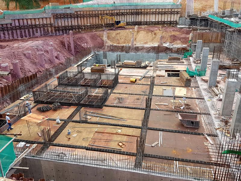 Building substructure and super-structure under construction using the open cut method. KUALA LUMPUR, MALAYSIA -JULY 04, 2018: Building substructure and super stock photo