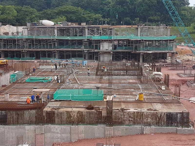 Building substructure and super-structure under construction using the open cut method. KUALA LUMPUR, MALAYSIA -JULY 04, 2018: Building substructure and super stock photos