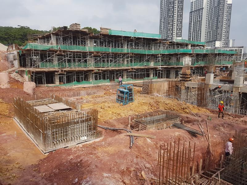 Building substructure and super-structure under construction using the open cut method. KUALA LUMPUR, MALAYSIA -JULY 04, 2018: Building substructure and super royalty free stock photo