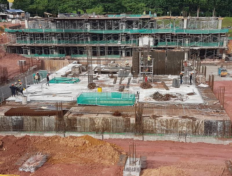 Building substructure and super-structure under construction using the open cut method. KUALA LUMPUR, MALAYSIA -JULY 04, 2018: Building substructure and super royalty free stock photos