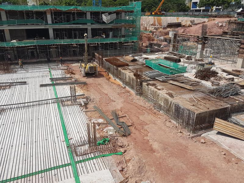 Building substructure and super-structure under construction using the open cut method. KUALA LUMPUR, MALAYSIA -JULY 04, 2018: Building substructure and super stock photography