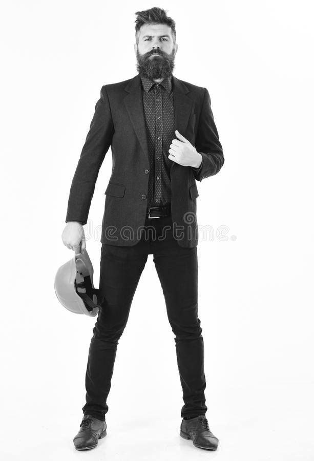 Building, success, proud, confidence, arrogance concept. Employer or site manager with arrogant face. Bearded man holds. Helmet isolated on white background stock image